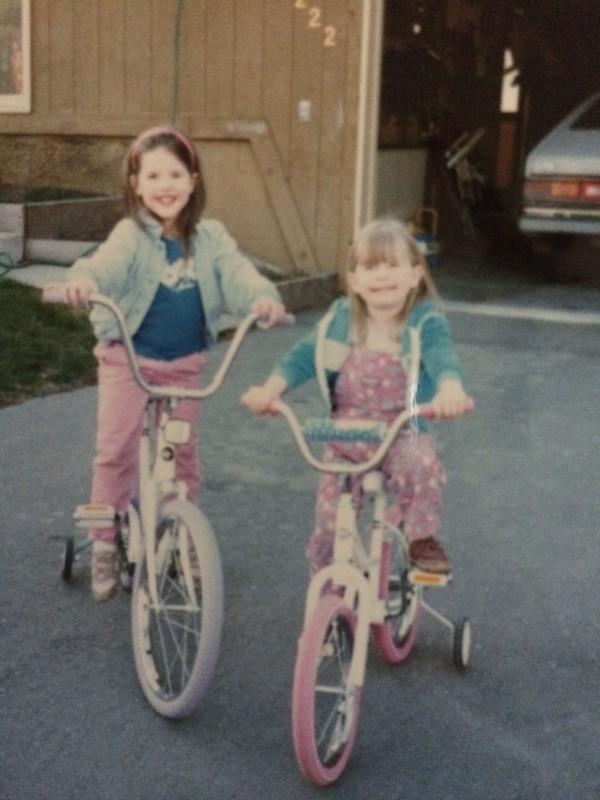 Jessica and Chelsea on bikes in Alaska